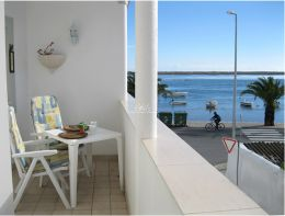 Front line apartment with terrace enjoying Santa Luzia lagoon views