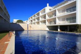 Stylish apartment in Fuseta frontline to lagoon with large sun terrace and pool and sea view