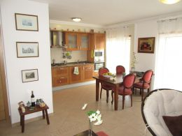 Immaculate apartment with lovely terraces and garage near beach and golf