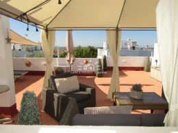 Top floor apartment with large private roof terrace and spectacular sea views