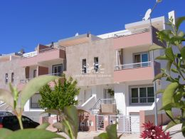 End of terrace 4 bedroom townhouse with large garage and sunny outside spaces in Tavira