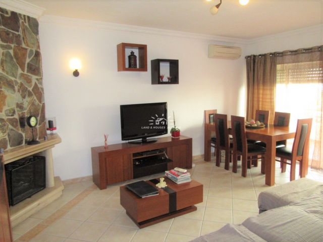 Living room of immaculate 3 bedroom apartment with large patio and parking space near Tavira