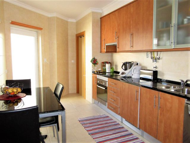 Kitchen of two bedroom apartment with private roof terrace in a residential area