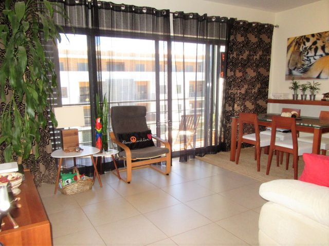 Living room of a modern 2 bedroom apartment with West-facing terrace and garage in centre of Tavira