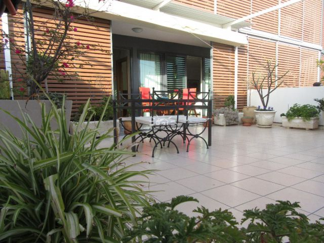 Terrace of modern city centre apartment with large terrace and garage in Tavira