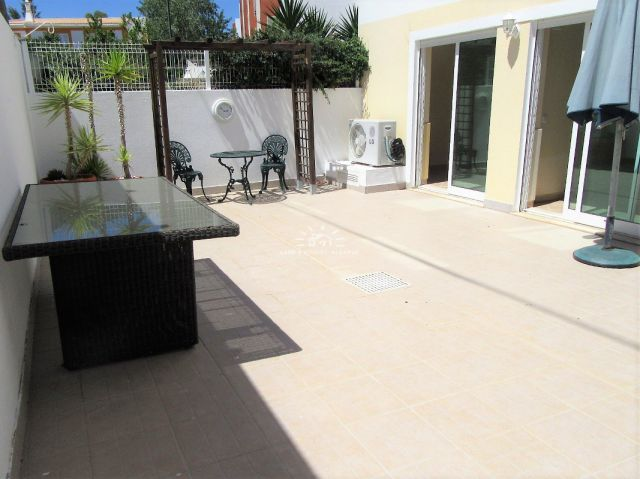 Large patio of spacious apartment in walking distance to Tavira town center