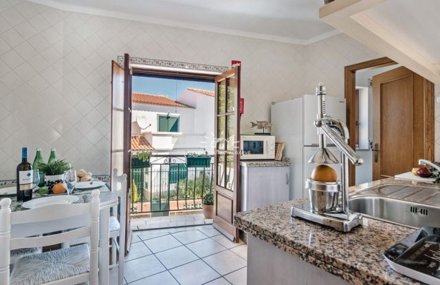 Charming fully furnished apartment with South facing balcony