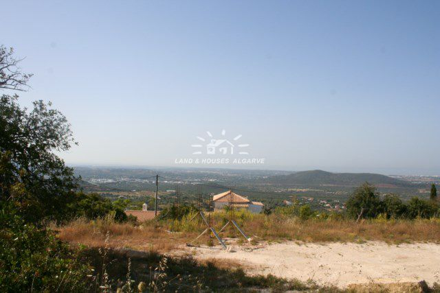 Large plot with project for sale near Loule for spacious villa with sea and country view