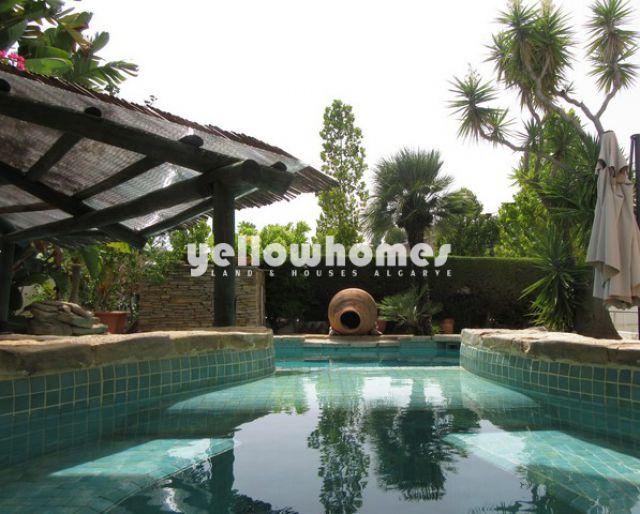 Villa mit Pool und wunderschönem Garten an Flusspromenade in Tavira