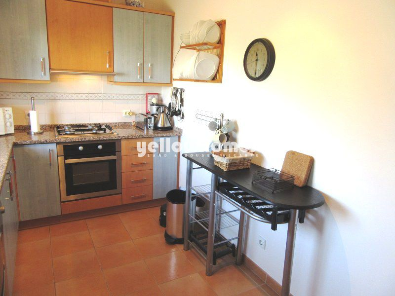 Well presented 2-bed townhouse in a small development with communal pool